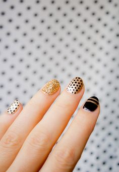 Follow this nail art tutorial to achieve a black + gold sparkly manicure with polka dots + stripes for the holidays.