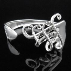 Fork Bracelet Silverware Jewelry - not sure I like the swirls, but Pinned more for the idea that you can do various things with the tines