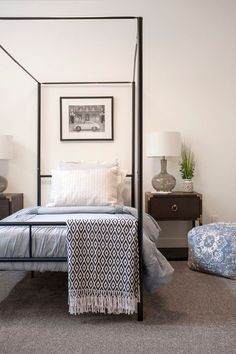 twin sized poster bed with small wooden nightstands and pale blue accents. Bedroom Sitting Room, Large Bedroom, Girls Bedroom, Sitting Rooms, Modern Farmhouse Exterior, Modern Farmhouse Style, Indoor Outdoor Fireplaces, Modern Teen Bedrooms, Barn House Plans
