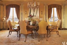 A Directoire dining table is paired with a suite of Queen Anne-style armchairs by Gregorius Pineo; the Biedermeier chandelier is from Therien & Co., the drawing is by Richard Serra, and the gilded-bronze sculpture at left is by Fletcher Benton.