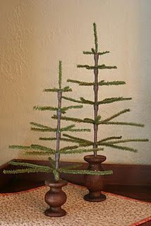 primitive handmade trees ~ they have bases made from wonderful turned walnut