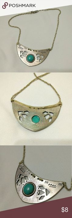Turquoise Southwestern Silver Necklace Sliver plate with turquoise gem at the center and triangle cut outs on the sides. Chain hangs at the collar bone, a has off white leather weaved through the chain links. Super cute!! American Eagle Outfitters Jewelry Necklaces