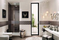 Tiling a border around this bathroom adds to its charm - compliment with tiles in the shower. Highly polished accents