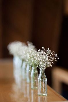 keep it simple. small jars with small flowers