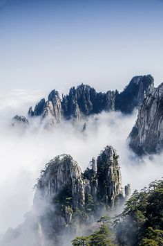 Mount Huangshan is attractive to the tourists for its grotesque rocks, dramatic pines and seas of clouds.