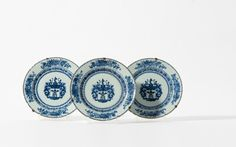 A series of three blue and white armorial plates, Qianlong period (1736-1795)