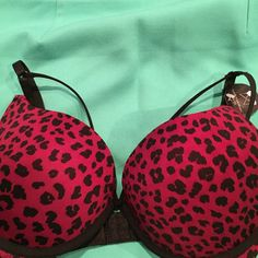NWT plunge push-up bar. 36D This is a gorgeous plunge push-up bra. Burgundy with black animal print. Very unique styling. His J hook back detail.Front has two black satin straps just above the cops that add a little bit of sexiness Intimates & Sleepwear Bras