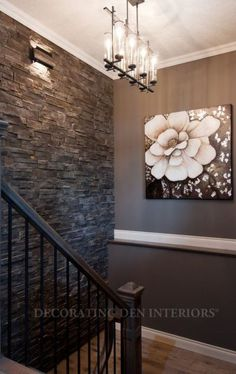 The best paint colour for a dark room or feature, accent wall could be Sherwin Williams Mink