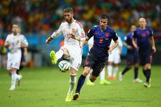 Sergio Ramos of Spain beats Robin van Persie of the Netherlands during the 2014 FIFA World Cup Brazil Group B match between Spain and Netherlands at Arena Fonte Nova on June 13, 2014 in Salvador, Brazil.