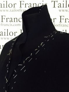 Work in Progress Coat with rounded collar with soft rounded a button to view, side pockets front.