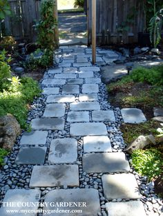 An inexpensive option for a beautiful path.  Flagstones and river rock garden…