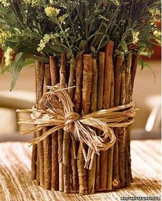 Love this. It might take more patience than the average DIY container, but imagine gathering the twigs with your kids and cutting them to fit the vase during naptime. When they wake up, they can help you gather the flowers and greens to fill the vase