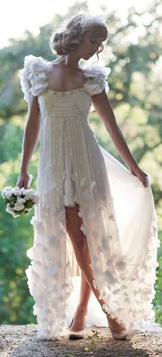 Temperley London Bridal. I like it, but with a higher bodice and high low that starts just above the knees.