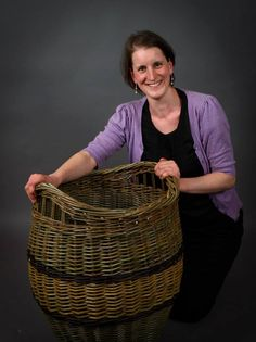 Large log basket made by Hanna Van Aelst barnabaunbasketry.ie