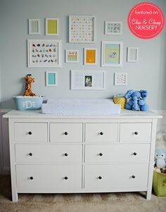 Hemnes dresser, but maybe in grey. Love the photo collage, maybe mixed with bird houses or letters