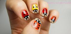 Liquid Leather and White on White were used to make these cute little lady bugs by Manicurator