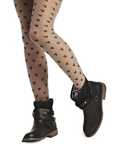 <p>Show your love for Mickey Mouse™ in chic style! The adorable tights feature a sheer knit body in a solid color with Mickey's iconic silhouette printed along the body. Tights have an elasticized waistband and a pull-on construction.</p>  <p>Model wears a size S/M.</p>  <ul> <li>84% Nylon / 16% Spandex</li> <li>Hand Wash</li> <li>Imported</li> </ul>