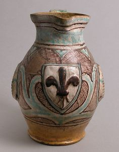 Jug   Date: late 14th–early 15th century  Geography: Made in probably Orvieto, Umbria, Italy  Culture: Italian  Medium: Earthenware, tin-glaze (Majolica)  Dimensions: Overall: 10 13/16 x 8 in. (27.4 x 20.3 cm)  Classification: Ceramics