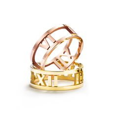 Make it a double. Atlas® open rings in 18k yellow and rose gold.