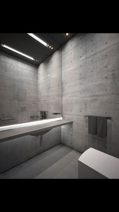 Pin 5: This bathroom features a lot of concrete giving it a real industrial feel. There is concrete panels with exposed studs on the wall and polished concrete floor and bench.