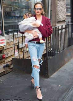 Pride and joy: Chrissy stepped out with her adorable baby girl, Luna, 12 months, in New York City earlier in the day
