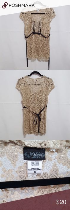 Gorgeous daytrip long top This is so pretty on !  Beautiful lace work - size xl but it fits smaller like a medium large - please check out my closet ❤😍 Daytrip Tops Blouses