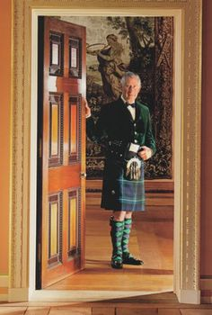 Prince Charles (known as the Duke of Rothesay when in Scotland) stands at the entrance to the Tapestry Room of Dumfries House, which was preserved for posterity through his efforts.