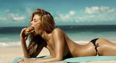 This is an ad for the 2013 Super Bowl. Once again women are sent conflicting messages. Being thin is sexy, but so is eating a giant hamburger...on the beach in a bikini.