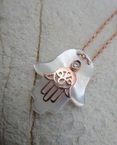 Two hands :-). hamsa hand of fatima sterling rose gold pendant simple chic artisan