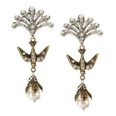 "Sweet Swallows of Sincerity Earrings Unique shaped natural pearl and bird dangle from intricate crystal fans. Perfect for the bride who wants a romantic and vintage feel. Post back style for pierced ears only. Mixed metal finishes of bronze and silver. Size- 2.75"" L x 1.125"" W Made by hand in California. Ships in 5-9 business days from USA (made to order) Free Shipping USA Gift Box Unique Earrings, Bridal Earrings, Statement Earrings, Drop Earrings, Sincerity Bridal, Ear Piercings, Swallows, Dangles, Bronze"