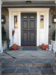 front door is Sherwin Williams Iron Ore. Love the stone steps. Painting an exterior door is great for curb appeal Black Front Doors, Painted Front Doors, Door Paint Colors, Front Door Colors, Exterior Colors, Exterior Design, Exterior Shutters, Exterior Trim, Exterior Paint