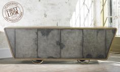High style takes shape at #lvmkt Jan28-Feb1 - Danish cabinet from @Julian Meyer Chichester offers a distinct silhouette and an aged finish called Black Vellum.