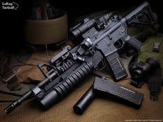 Colt M4 Carbine (SOPMOD STYLE) with KAC RAS Handguard, KAC Vertical Grip, Magpul CTR Stock, M203 Grenade Launcher
