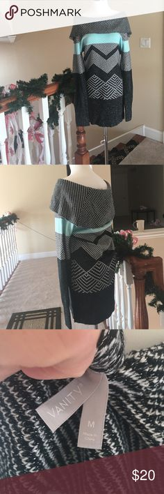 ❤️Sweater dress❤️ Black shimmering material, teal and white make up this sweater dress! The material is soft, not bulky.  I wore it a couple times and I wore the neck different ways, you can wear it more off shoulder or as a cowl neck Vanity Dresses