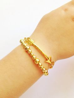 Graduated gold bead bracelet by JuneandPenny on Etsy