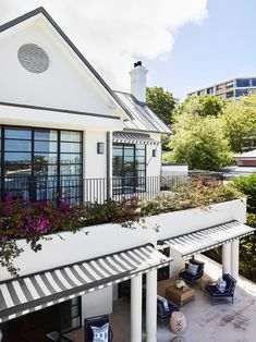 Banks of steel-framed windows embrace the harbour view. from this Federation house. | Story: Belle