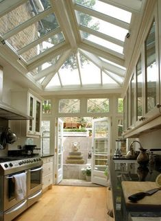 A conservatory kitchen can be traditional or modern with glass walls and ceilings that maximize light and sun.