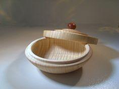 figured maple turned box with amboina knob