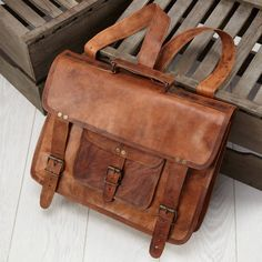 Leather Briefcase Backpack with perfect brown tanning and amazing look to it.