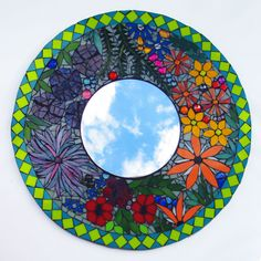 Both mosaics have the same theme. Colorful Stained Glass Round Floral Mosaic Tile Mirror. • Stained glass mosaic tile encased in dark gray grout. Mosaic Flower Mirror. • Handmade by professional mosaic tile art specialist (me). | OffbeatBling on eBay!