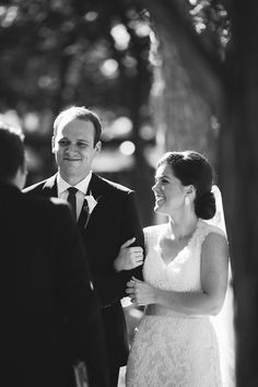 A lovely shot of the bride and groom during the ceremony. | Swoon over this charming #wedding full of simple style: http://www.mywedding.com/articles/billy-and-amandas-lovely-austin-tx-wedding-by-meredith-bacon-photography/