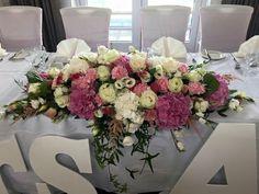 A gorgeous top table arrangement #weddingseason #parsleyandsage