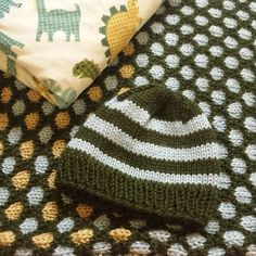 Honeycomb Stitch blanket with matching striped hat. #knitting
