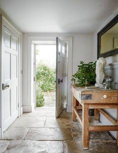 An eighteenth-century weavers' cottage lovingly restored Entrance hall - love the flagstone flooring Hallway Ideas Entrance Narrow, Entrance Ways, House Entrance, Modern Hallway, Modern Staircase, Small Entrance Halls, Spiral Staircases, Entry Hall, Staircase Design