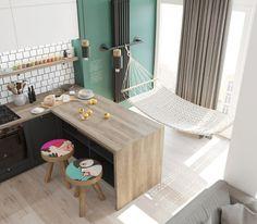 Otwarta kuchnia łączy się z salonem, ale w miejscu tradycyjnej jadalni... zawieszono hamak, który tworzy świetne...
