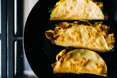 Crispy breakfast quesadillas filled with broccoli, cheddar and scrambled eggs.