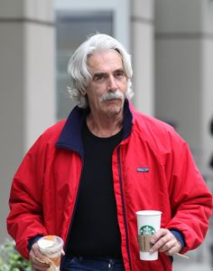 """Sam Elliott Photos - Actor Sam Elliott grabs coffee, parfait and a pastry from Starbucks after finishing up his role on """"The Company You Keep"""" in Vancouver. - Exclusive: Sam Elliott Getting Starbucks In Vancouver Actor Sam Elliott, Vancouver, Starbucks, In Hollywood, Portrait Photography, Rain Jacket, Windbreaker, Actors, Portraits"""