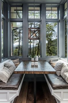 A cozy breakfast nook with windows and textured textiles