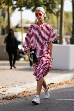 PARIS, FRANCE - SEPTEMBER 29: A guest wears a white and red striped dress, outside Issey Miyake, during Paris Fashion Week Womenswear Spring/Summer 2018, on September 29, 2017 in Paris, France. (Photo by Edward Berthelot/Getty Images)