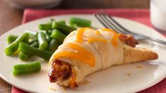 Easy BBZ Chicken Crescents Ingredients 1 can (8 oz) Pillsbury™ refrigerated crescent dinner rolls  8 frozen fully cooked chicken breast strips  3 T barbecue sauce 1/3 cup shredded Cheddar cheese